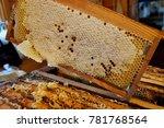 beekeeper holding a frame of... | Shutterstock . vector #781768564