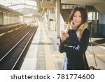 traveler woman use smartphone... | Shutterstock . vector #781774600