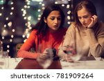 two adolescent women sitting in ... | Shutterstock . vector #781909264