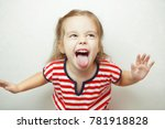 angry little girl shows her... | Shutterstock . vector #781918828