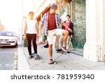 teenage friends walking at the... | Shutterstock . vector #781959340