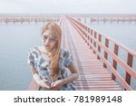 thinking woman on the bridge.... | Shutterstock . vector #781989148