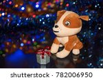 a soft puppy toy with a gift... | Shutterstock . vector #782006950