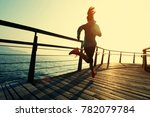 sporty fitness female runner... | Shutterstock . vector #782079784