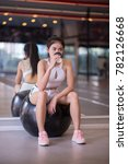 Small photo of Young women sit and drink coffee after exercise. finess and exercise concept.