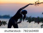 healthy woman warming up... | Shutterstock . vector #782163400