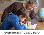 young little shoolboy solving... | Shutterstock . vector #782175070