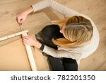 young woman assembling... | Shutterstock . vector #782201350