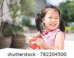 happy little asian girl in... | Shutterstock . vector #782204500