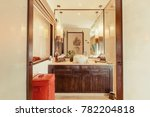 Small photo of Shower cabin in bathroom interior luxury asian style, big lamps, wooden brown ambry