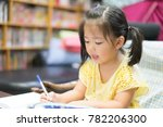 cute little girl doing homework ... | Shutterstock . vector #782206300