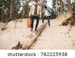 Small photo of Travelers descend along the sandy slope on the tree. Dangerous route. Extreme hike.