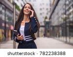 happy business woman talking on ... | Shutterstock . vector #782238388