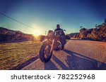 man on a classic motorcycle on...   Shutterstock . vector #782252968
