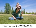little child playing to try to... | Shutterstock . vector #782265526
