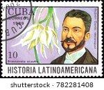 "Small photo of CUBA - CIRCA 1989: A stamp shows a Brassavola acaulis and Ruben Dario, series ""Historia Latinoamericana"", circa 1989"