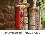 Red Postbox On An Antique Bric...