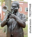 Small photo of Cheraw, SC / USA - April 2 2016: A statute of native son Dizzy Gillespie stands in the town green of Cheraw, SC.