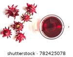 Small photo of Roselle - Fresh Roselle and cup of hot organic Roselle tea for a healthy drink on white background. Top view