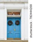 Blue Door With Christmas Wreath