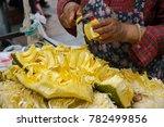 street vendor cut open peeling... | Shutterstock . vector #782499856