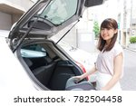 young woman going out by car | Shutterstock . vector #782504458