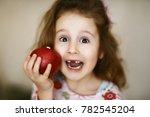 a cute little curly toothless... | Shutterstock . vector #782545204