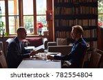 two businessmen meeting in cafe | Shutterstock . vector #782554804