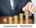 businessman hand holding one... | Shutterstock . vector #782556520
