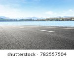 asphalt road and lake with... | Shutterstock . vector #782557504