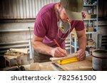 a young strong man builder... | Shutterstock . vector #782561500