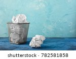 a trash can with papers  one... | Shutterstock . vector #782581858