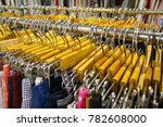 Small photo of wooden clothes hangers in clothe shop