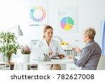 smiling dietitian in uniform... | Shutterstock . vector #782627008