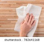 hand of woman wiping wooden...   Shutterstock . vector #782641168