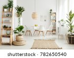 pouf and brown rug near white... | Shutterstock . vector #782650540