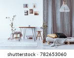 lamp above bed with pillows ... | Shutterstock . vector #782653060