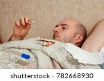 ill man lies in bed with... | Shutterstock . vector #782668930