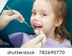 child lies in dentist chair and ... | Shutterstock . vector #782690770