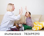 happy mother and son playing... | Shutterstock . vector #782699293