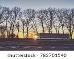 a truck is driving along a road ... | Shutterstock . vector #782701540