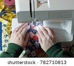 hands using a sewing machine | Shutterstock . vector #782710813