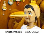 Small photo of Wooden Pinocchio doll with long nose