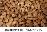 Small photo of Almonds. Raw almonds with shells. Raw fresh organic almond nuts. Almond background. Nuts background. Almond texture and background