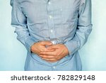 businessman holding his stomach ... | Shutterstock . vector #782829148
