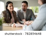couple in bank office signing... | Shutterstock . vector #782854648