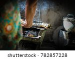 grilling fish on the fireplace... | Shutterstock . vector #782857228