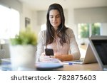 startup girl working in office... | Shutterstock . vector #782875603