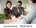 couple in bank office signing... | Shutterstock . vector #782875816