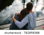 man embracing a woman on the... | Shutterstock . vector #782898388
